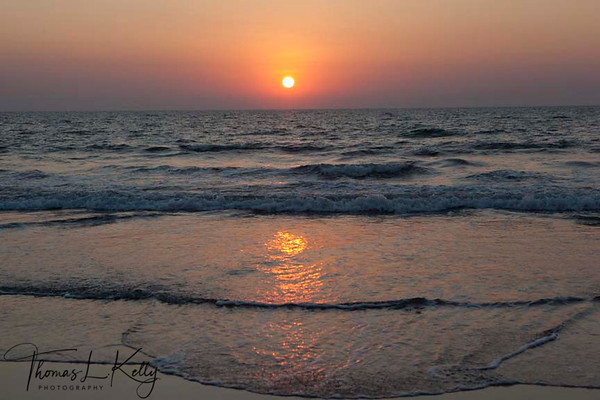 Sunset glows Arabian sea at aswem beach which is famous for its beach shack and some good accomodation in the form of little resorts. It is also bit unconventional for being rock beach. Goa, India.