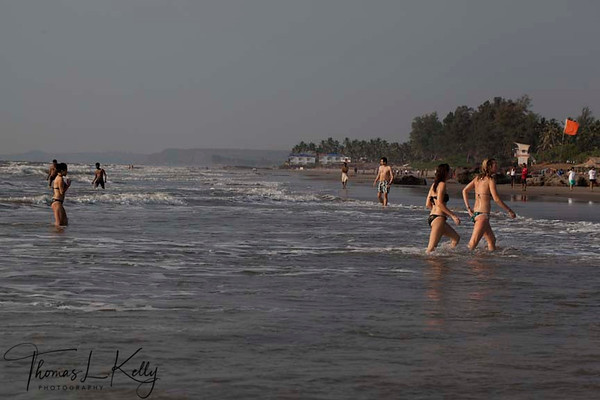 Tourist having wonderful family time at Anjuna Beach which is situated eight kilometers west of Mapusa, it is the most happening of all beaches, one rather say its the mother of all beaches in Goa. India.