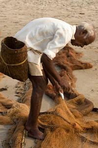 Fishermen at work. Baga beach.