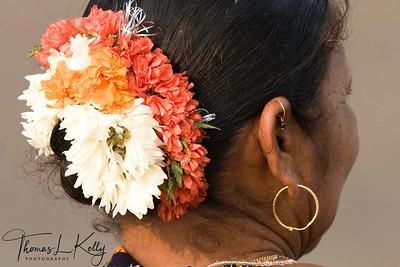 Fisher-woman wears Gajra (flower head wear). Baga Beach.