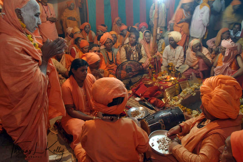 New initiate and members of Juna Akhara, reciting mantras (sacred words of empowerment).