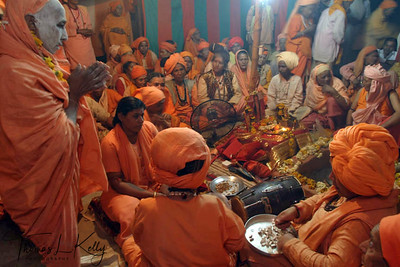 New initiate and members of Juna Akhara, reciting mantras (sacred words of empowerment). Ujjain, India.