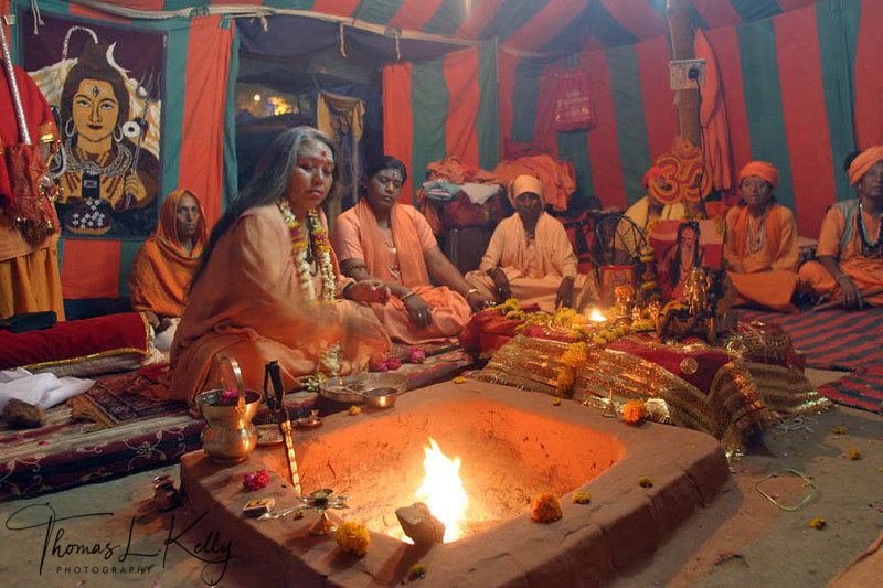 Meera Puri, Making offerings to fire goddess, agni, the ultimate witness, who is believed to sanctify this union between the new initiate and Lord Shiva. Ujjain, India.
