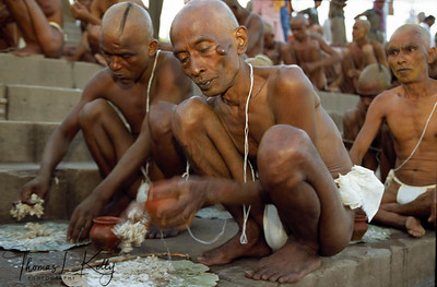 Hundreds of about to be monks of the Abahan Akhara, are initiated on the Ram Ghat above the Sipara River. Both male and female initiation takes place at this great gathering during Ujjain Kumbha Mela. Ujjain, India.