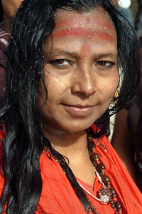 Shaivite sadhvis, or female renouncers, just after taking a holy dip at river Ganga. Ujjain, India. To my sisters, I say do not give importance to the idea that a woman is weak, Go with self-confidence in life, then no one can discourage you.  - Santoshi Mata Ji  Ujjain, India.