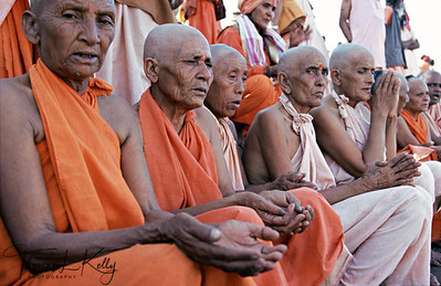 No one knows when the first Kumbha Mela took place. Distinguished as the largest religious festival on earth, it occurs in only four places. At the Ujjain Kumbha Mela-2004, 30 million devotees gathered on the shores of the Sipara river in Ujjain to be blessed and purified. Seen here are the sadhvis renunciates making holy water offerings from their clay pots as a symbol that they have been purified. Ujjain, India.