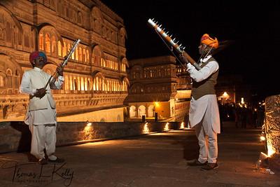Rajasthan folk musicians playing string instrument called sarangi welcome you to the Mehrangarh Fort. Jodhpur, Rajasthan, India.