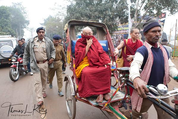 Tibetan monk take rickshaw to the main temple in Bodhgaya. Kalachakra Initiation in Bodhgaya, Bihar, India. (Jan-2012)