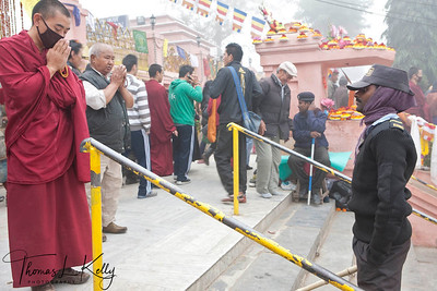 Buddhist pilgrims praying in front of the Mahabodhi Temple. Kalachakra Initiation in Bodhgaya, India. (Jan-2012)