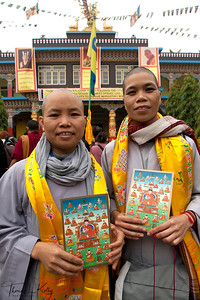 Buddhist nuns in front of Tergar Monastery in Maha Bodhi Temple. Kalachakra Initiation in Bodhgaya, India. (Jan-2012)