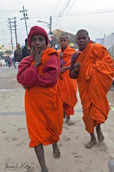 Young Bihari monks or sadhus go to the main temple in Bodhgaya in the hope of alms. Kalachakra Initiation in Bodhgaya, Bihar, India. (Jan-2012)