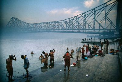 Morning bath at Howrah Bridge.  Kolkata, India.