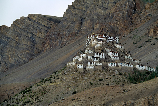 Stacked like matchboxes, Ki monastery uses every inch of space available in the hilly terrain. The basement of the monastery has a cache of arms, the remains of turbulent past. Ladakh India.
