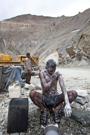 Bihari Labourer take bathing break in between work. Lama Yuru, Ladakh India.