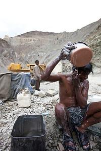 Bihari Labourer take bathing break in between work. Lama Yuru, Ladakh India.
