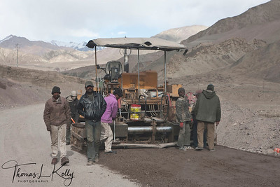 The road, for the most part, is a painstakingly handmade affair built and maintained by labourers from Bihar state of India. They are subjected to excruciating and extremely dangerous working conditions. The workers are woefully ill-equipped and under-dressed and although the army purports to lend them winter clothing suitable for the extremity of the weather at these altitudes, many of the workers were visibly suffering from the cold. Ladkha, India.