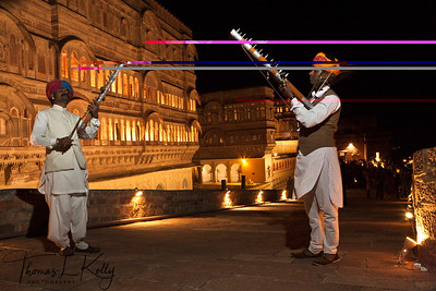 Rajasthan folk musicians playing string instrument called sarangi welcome you to the Mehrangarh Fort.