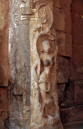 Various carvings of apsaras, the celestial dancing maidens, and the temple prostitutes who are considered their incarnation on earth. Hampi, Karnataka, India.