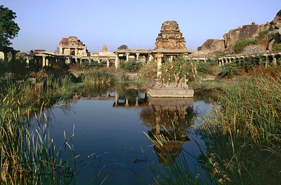 Krishna Temple complex as seen across the reedy pond. Hampi, Karnataka, India.