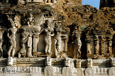 The western gateway leading into the ancient city of Vijayanagar, decorated with the voluptuous forms of apsaras, celestial dancing maidens. Hampi, Karnataka, India.