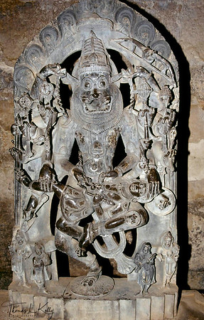 Image of Narasima, here graphically shown disemboweling the demon Hiranyakasipu- detail from the Hazara Rama Temple. Hampi, Karnataka, India.