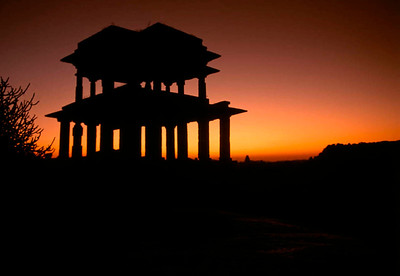 The Jain Temple silhouetted by the last light of the day as the coolness of a desert night descends on Hampi. Hampi, Karnataka, India.