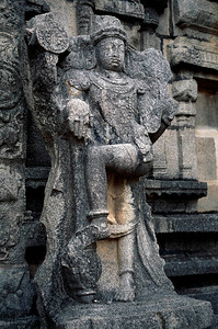 Nataraja, a manifestation of the Lord Shiva as the cosmic dancer of creation and destruction- detail from the Hazara Rama Temple. Hampi, Karnataka, India.