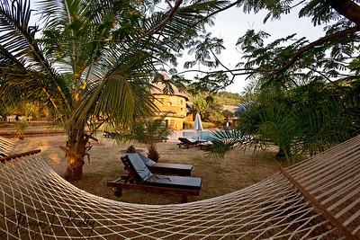 Hammock and rest benches by poolside in Swaswara in Gokarna, Karnataka, India.