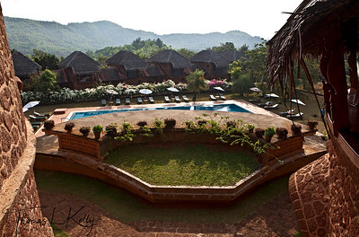 View of swimming pool with the lines of 27 self contained villa of Swaswara built in the local Konkan style, ont he background. Gokarna, Karnataka, India.