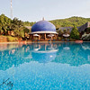 The centerpiece of SwaSwara is the blue meditation dome, at the head of the swimming pool.Its circular form and blue tiles form a mandala ( or cosmic sphere ) of harmony, echoing the temple architecture of nearby Gokarna. Karnataka, India.