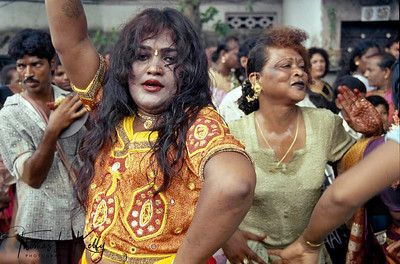 Straight gawkiers enjoy and tease as the parade of hijras pass on the streets of Villupurum gathered for an annual festival of transsexuals at the Temple of Aravan.