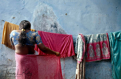 Hijaras getting ready to be married to the South Indian temple god, in an age-old rite performed by the sweating, topless temple priest, a re-enactment of the marriage of Mohini (a female incarnation of Lord Krishna) and Aravan related in the Hindu mythological epic, Mahabharata.