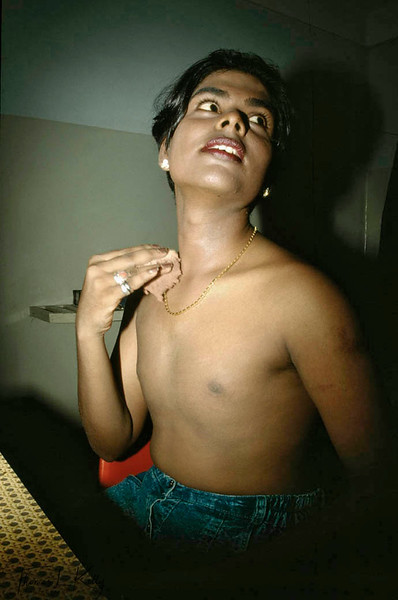 Samson, a counselor for Prakriti Sahodaran, a men sexual health project powders up as he gets ready to go out for work at the annual Aravan festival which attracts trans-sexuals from all over the country.