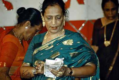 "Hijaras counting cash collected by dancing. Called ""minstrels of the night"", the hijras  are South Asia's ridiculed and ostracized third gender-eunuchs  and trans-sexuals-who  are  deemed auspicious  at  wedding parties and birth ceremonies- but  otherwise  outcast  as nature's  freaks."
