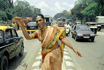 Enthusiastic contestants after the Prakriti Sahodaran-sponsored, drag beauty pageant, runs dancing on the main street lane.