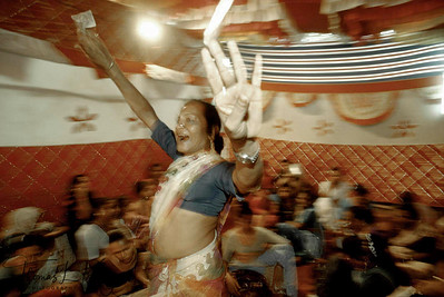 "Hijaras dancing. Called ""minstrels of the night"", the hijras  are South Asia's ridiculed and ostracized third gender-eunuchs  and trans-sexuals-who  are  deemed auspicious  at  wedding parties and birth ceremonies- but  otherwise  outcast  as nature's  freaks."