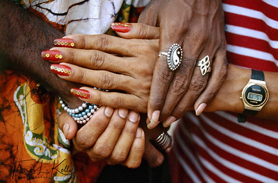 The hands of a hijra displaying sequined nail-polish.