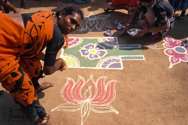 Auspicious rice-flour mandala (calledn Rangoli in Hindi language) painted on the ground to mark the various halting points of the chariot of Aravan as it is borne through the streets in procession, Aravan temple festival, Villupurum, South India.