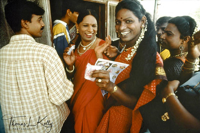 The Prakriti Sahodaran social workers on their way to the annual Aravan temple festival  south of Chennai (Madras) which attracts hijras (trans-sexuals) from all over India. The Sahodaran workers in drag pass out condoms and give counseling to the trans-sexuals.