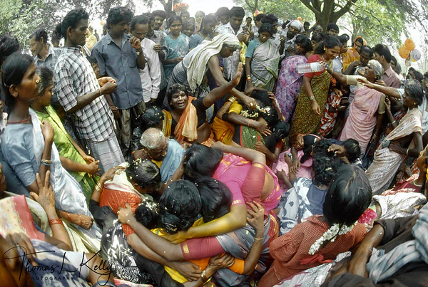 The wailing widows of Aravan. After the god is symbolically killed those hijras (transsexuals) who had been ritually married to the god the night before now express their grief at being single and alone once again, ridiculed and ostracized as third gender freaks. Annual Aravan temple festival, Villupurum, South India.