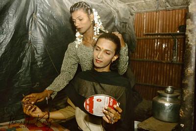 A hijra (eunuchs) putting make-up at Prakriti Sahodaran sponsored beauty pageant, Villupuram.