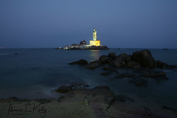 """India's statue of liberation. A 133-foot statue of Saint Thiruvalluvar joins the memorial to Swami Vivekananada, just offshore at Indian's southernmost tip. A view from the shoreline of Kanya Kumari. Shows the Vivekananada Rock on the left and towering Valluvar statue on right Several hundred yards off shore and reachable only by boat. Kanya Kumari, India.  Thiruvalluvar, was a celebrated Tamil poet and philosopher whose contribution to Tamil literature is the Thirukkural, a work on ethics. Thiruvalluvar is thought to have lived sometime between the 2nd century BC and the 8th century AD. This estimate is based on linguistic analysis of his writings, as there is no archaeological evidence for when he lived. He is sometimes also called Theiva Pulavar (""""Divine Poet""""), Valluvar, Poyyamozhi Pulavar, Senna Pothar, Gnana Vettiyan or Ayyan."""