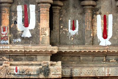 Red and white of Tilaka symbolizes the combination of male and female (Lord Vishnu and Goddess Laxmi)