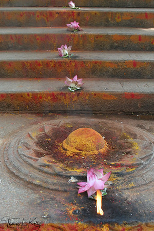 Pilgrims make offering of vermilion paste of divine colors, lotus, camphor, and devotional lights to Alipiri steps.