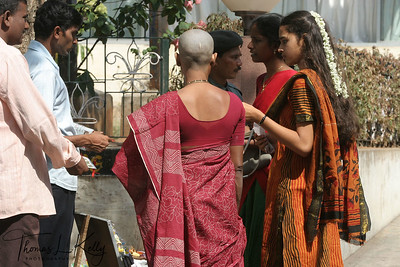 "Shaved headed woman . A head shaving in Balaji Temple is referred to as a ""hair-offering ceremony"". The purpose of this sometimes-disconcerting experience is to foster humility and purity, to mitigate past karma and for the good fortune."