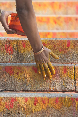 Pilgrims make offering of vermilion paste of divine colors, lotus, camphor, and devotional lights to Alipiri steps.