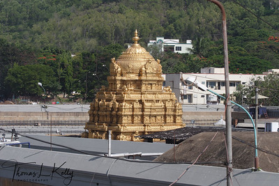 Tirumala's gold-plated main temple radiant with gold at day break . It is one of the India's grand Vishnu's temple famous for its extraordinary wealth and undying service to the poor.