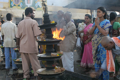 Various activities before entering the temple. Like, offering coconuts and camphor, lighting devotional lamp etc.