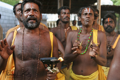 Sadhus chant mantra (sacred verses) and sing devotional song as they ascend Alipiri Walkway.