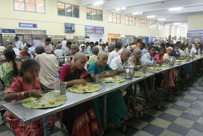 Pilgrims eating at Annadanya complex run by Annadanya Trust. Annadanya Trust's main idea is to serve pilgrims with free fooding. They feed almost 20-25 thousand pilgrims everyday,5 thousand kg of rice with one curry, chutney, rasim, and one laddoo. The food is very Satvic (complete vegetarian, no onion, no garlic). Boys in orange shirt and women with orange scarf are the volunteers. Annadanya Trust is said to be blessed with Goddess Annapurna, (i.e anna = food, purna = full). Annapurna is Goddess for food.